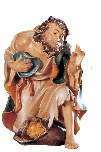 Shepherd kneeling with fruit